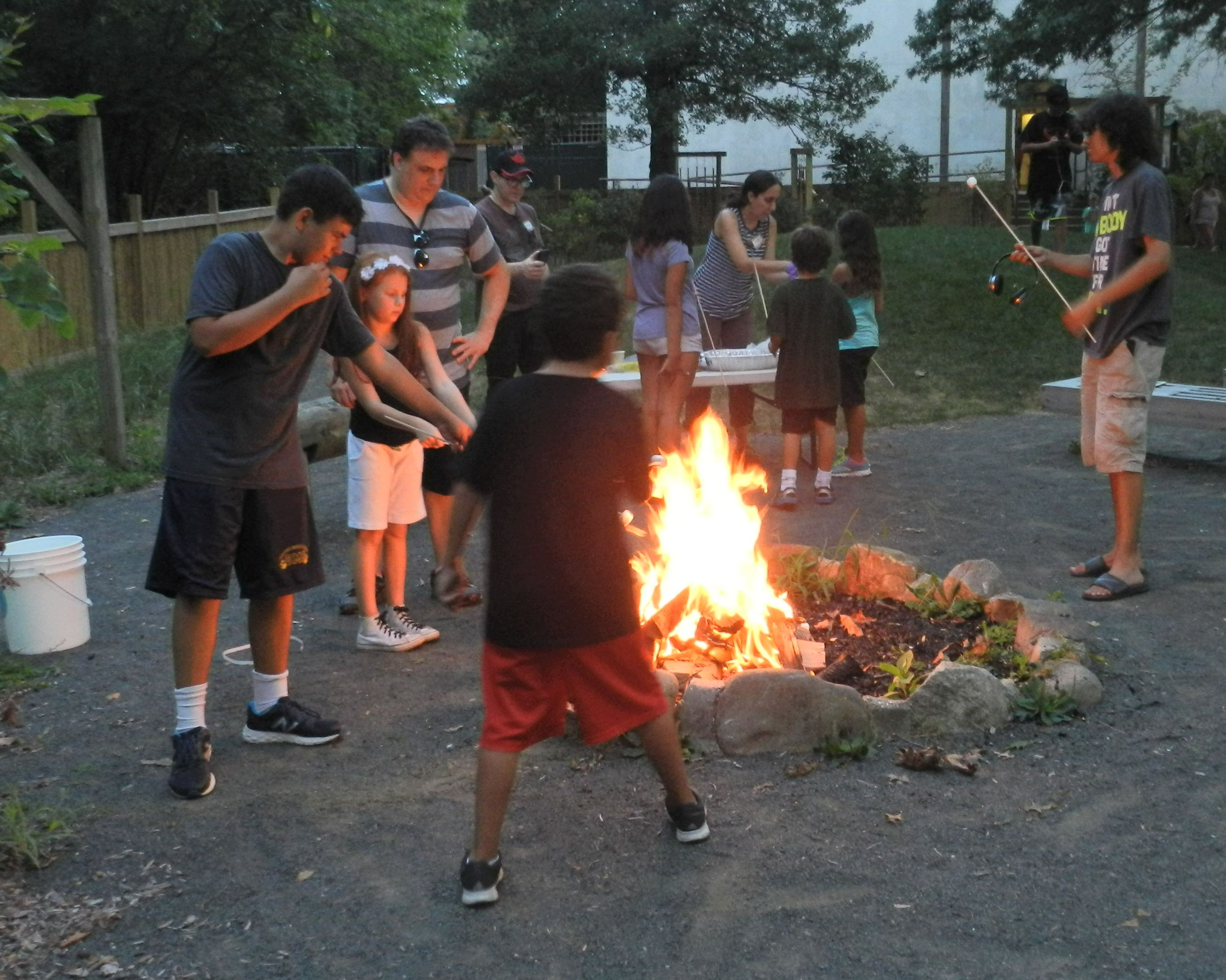 Making Smores around the campfire at the Pokemon Go! Program
